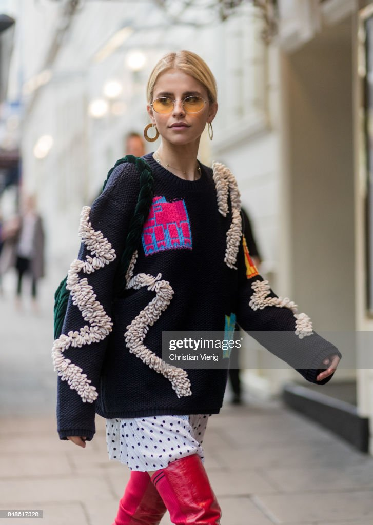 Caroline Daur wearing knit, red overknee boots outside Peter Pilotto during London Fashion Week September 2017 on September 17, 2017 in London, England.