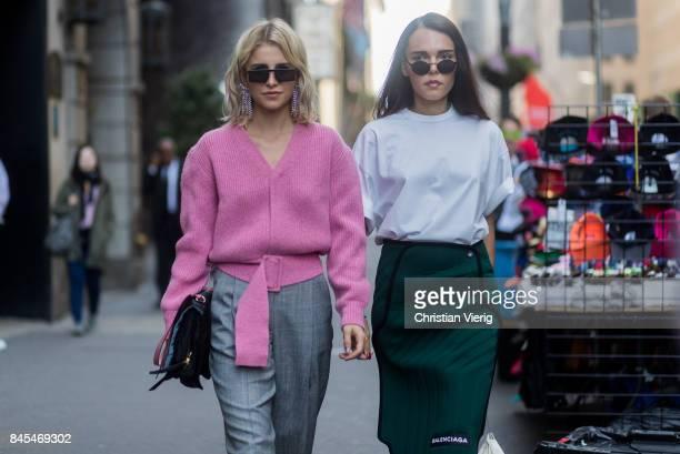 Caroline Daur wearing pink knit and Evangelie Smyrniotaki wearing green Balenciaga skirt seen in the streets of Manhattan outside Victoria Beckham...