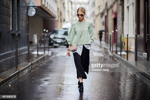 Caroline Daur wearing shoes and bag Zara shirt Holly Ghost and sweater Elisabetta Franchi during the Paris Fashion Week Womenswear Spring/Summer 2016...