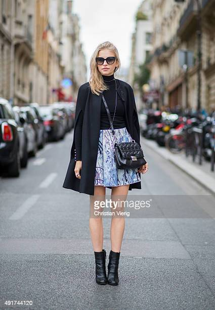 Caroline Daur wearing shoes and caoe Zara sweater Topshop skirt Elisabeths Franchi bag Karl Lagerfeld sunglasses Prada at Miu Miu during the Paris...