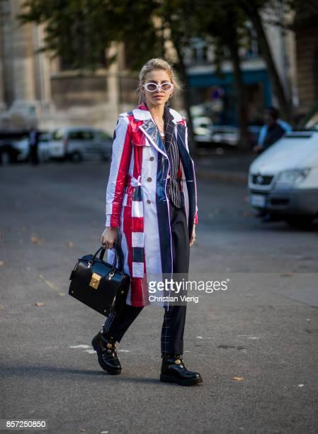 Caroline Daur wearing striped coat seen outside Thom Browne during Paris Fashion Week Spring/Summer 2018 on October 3 2017 in Paris France
