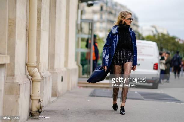 Caroline Daur wears a blue coat outside Giambattista Valli during Paris Fashion Week Womenswear Spring/Summer 2018 on October 2 2017 in Paris France