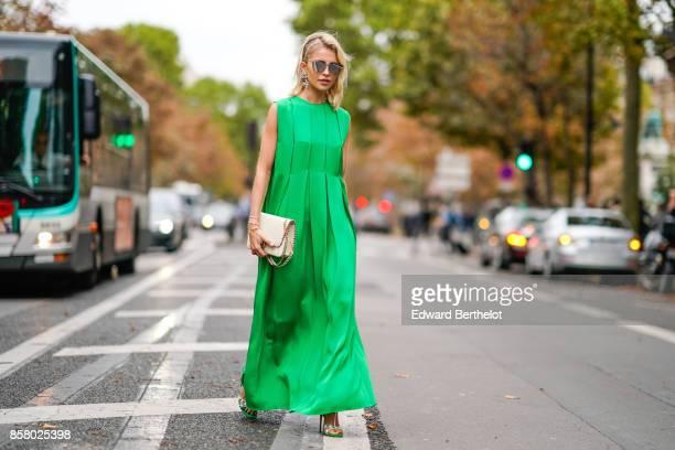 Caroline Daur wears a green dress outside Valentino during Paris Fashion Week Womenswear Spring/Summer 2018 on October 1 2017 in Paris France