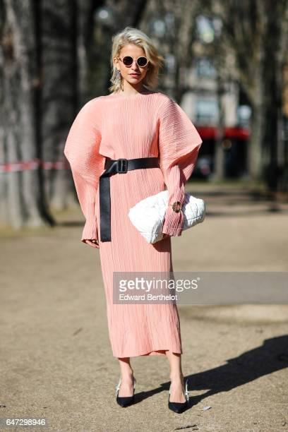 Caroline Daur wears a pink dress outside the Chloe show during Paris Fashion Week Womenswear Fall/Winter 2017/2018 on March 2 2017 in Paris France