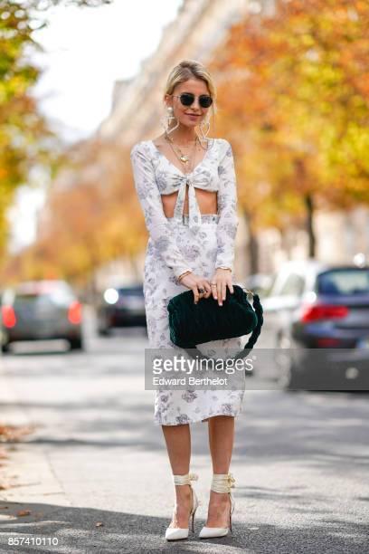 Caroline Daur wears a skirt a bare belly top a green bag outside Miu Miu during Paris Fashion Week Womenswear Spring/Summer 2018 on October 3 2017 in...