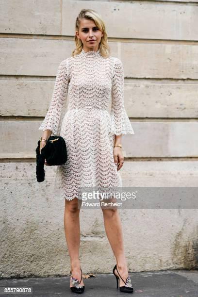 Caroline Daur wears a white dress outside Kaviar Gauche during Paris Fashion Week Womenswear Spring/Summer 2018 on September 29 2017 in Paris France