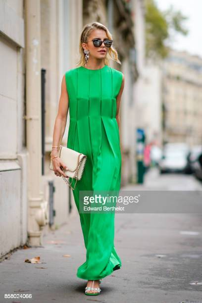 Caroline Daur wears sunglasses a white bag and a green dress outside Valentino during Paris Fashion Week Womenswear Spring/Summer 2018 on October 1...