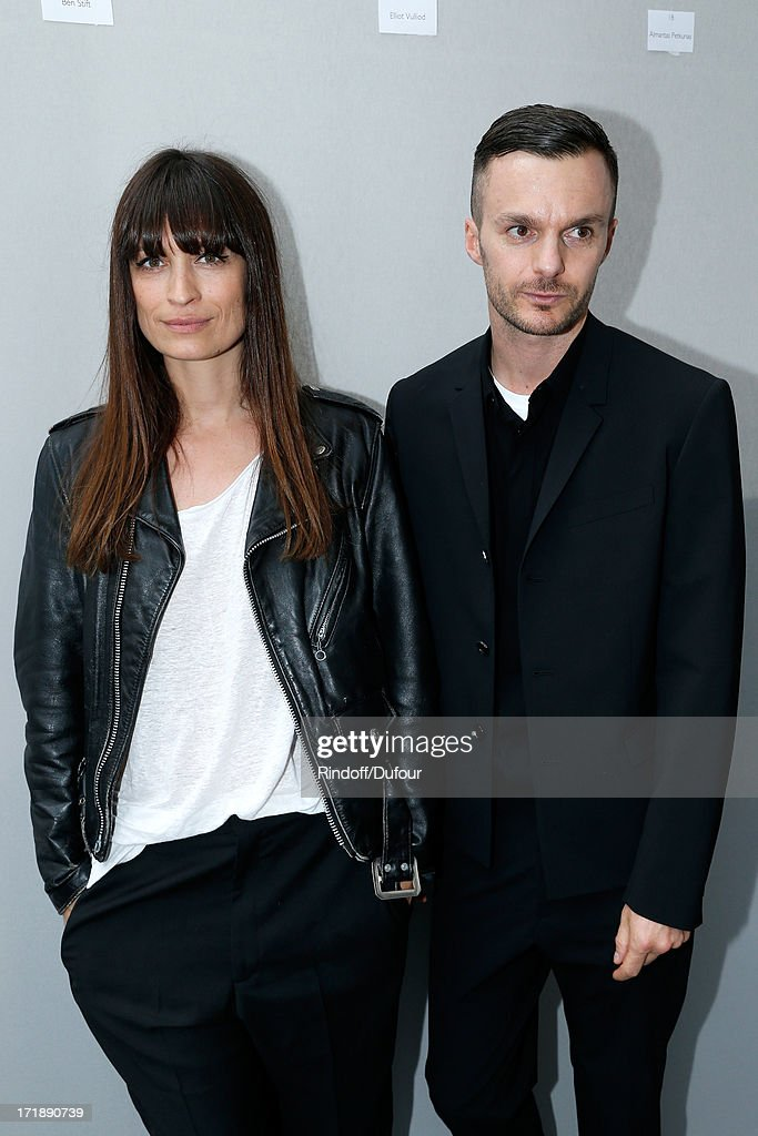 Caroline de Maigret and Fashion designer Kris Van Assche backstage after Dior Homme Menswear Spring/Summer 2014 Show as part of the Paris Fashion Week on June 29, 2013 in Paris, France.