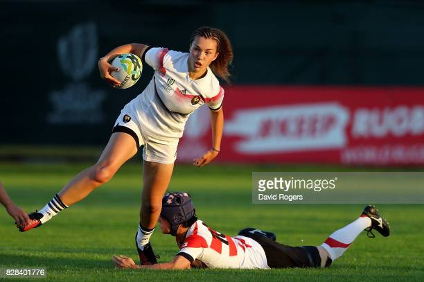 Caroline Drouin of France is tackled by Minori Yamamoto of Japan during the Women's Rugby World Cup 2017 match between France and Japan on August 9...
