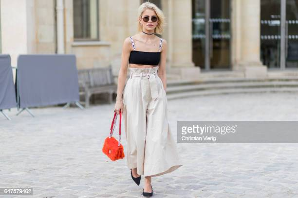 Caroline Duar wearing high waisted pants Dior bra outside Dior on March 3 2017 in Paris France