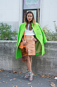 Caroline Durant is wearing a Maria Hoermanseder skirt APC top Acne jacket Proenza Schouler bag and Peter Pilotto shoes on day 4 of Paris Collections...