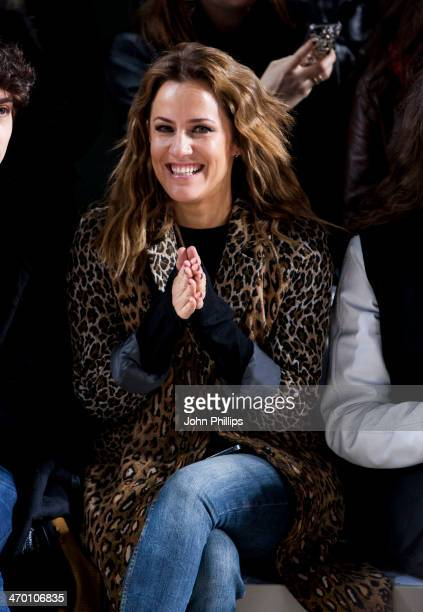 Caroline Flack attends the Fashion East show at London Fashion Week AW14 at Tate Modern on February 18 2014 in London England