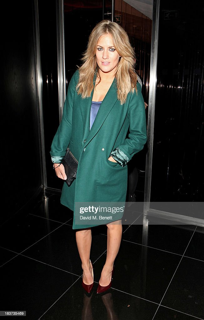<a gi-track='captionPersonalityLinkClicked' href=/galleries/search?phrase=Caroline+Flack&family=editorial&specificpeople=4344399 ng-click='$event.stopPropagation()'>Caroline Flack</a> attends the launch of The Vinyl Collection curated by Annie Mac and the AMP 2013 album at W London - Leicester Square on October 9, 2013 in London, England.