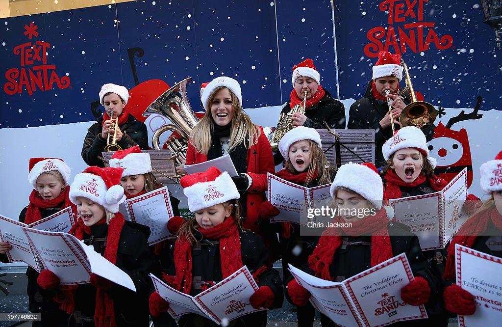 Caroline Flack gets festive with some charity carol singing on Oxford Street raising money with her personal Vodafone JustTextGiving code for this...
