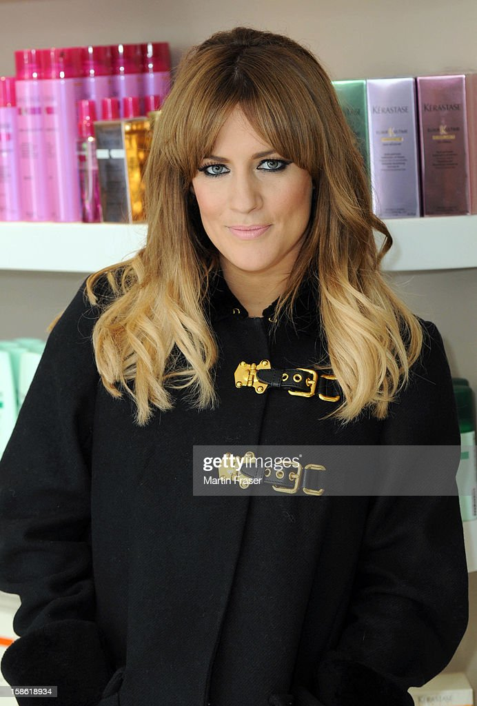 Caroline Flack has a festive fringe cut at Regis Salons in Jenners Edinburgh, wearing the Miu Miu coat received as a birthday present from Olly Murs on December 21, 2012 in Edinburgh, Scotland.