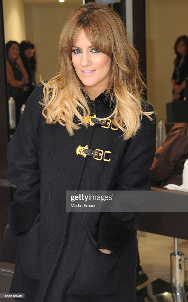 <a gi-track='captionPersonalityLinkClicked' href=/galleries/search?phrase=Caroline+Flack&family=editorial&specificpeople=4344399 ng-click='$event.stopPropagation()'>Caroline Flack</a> has a festive fringe cut at Regis Salons in Jenners Edinburgh, wearing the Miu Miu coat received as a birthday present from Olly Murs on December 21, 2012 in Edinburgh, Scotland.