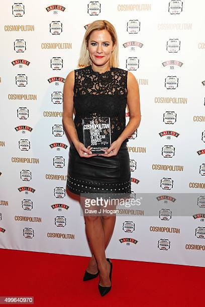 Caroline Flack poses for a photo with the award for TV Personality during the Cosmopolitan Ultimate Women Of The Year Awards at One Mayfair on...