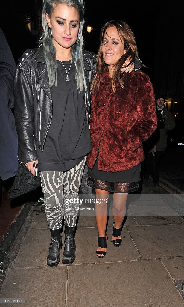 <a gi-track='captionPersonalityLinkClicked' href=/galleries/search?phrase=Caroline+Flack&family=editorial&specificpeople=4344399 ng-click='$event.stopPropagation()'>Caroline Flack</a> (right) sighting at the Groucho Club on January 31, 2013 in London, England.