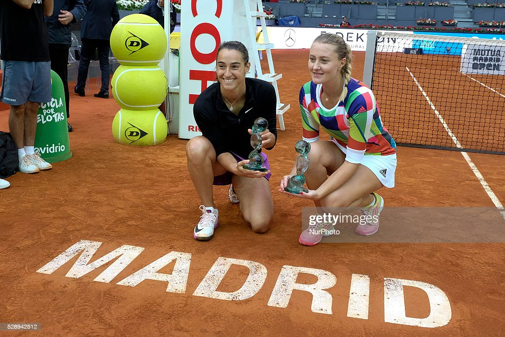<a gi-track='captionPersonalityLinkClicked' href=/galleries/search?phrase=Caroline+Garcia&family=editorial&specificpeople=6605758 ng-click='$event.stopPropagation()'>Caroline Garcia</a> and <a gi-track='captionPersonalityLinkClicked' href=/galleries/search?phrase=Kristina+Mladenovic&family=editorial&specificpeople=4835181 ng-click='$event.stopPropagation()'>Kristina Mladenovic</a> of France celebrates in the doubles final during day eight of the Mutua Madrid Open tennis tournament at the Caja Magica on May 07, 2016 in Madrid, Spain.