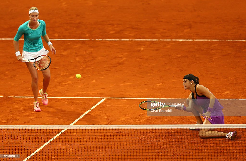 <a gi-track='captionPersonalityLinkClicked' href=/galleries/search?phrase=Caroline+Garcia&family=editorial&specificpeople=6605758 ng-click='$event.stopPropagation()'>Caroline Garcia</a> and <a gi-track='captionPersonalityLinkClicked' href=/galleries/search?phrase=Kristina+Mladenovic&family=editorial&specificpeople=4835181 ng-click='$event.stopPropagation()'>Kristina Mladenovic</a> of France in action against Elena Vesnina and Ekaterina Makarova of Russia in their doubles semi final match during day seven of the Mutua Madrid Open tennis tournament at the Caja Magica on May 06, 2016 in Madrid,Spain.