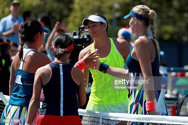 Caroline Garcia and Kristina Mladenovic of France shake hands after defeating Eri Hozumi and Miyu Kato of Japan during their third round Women's...