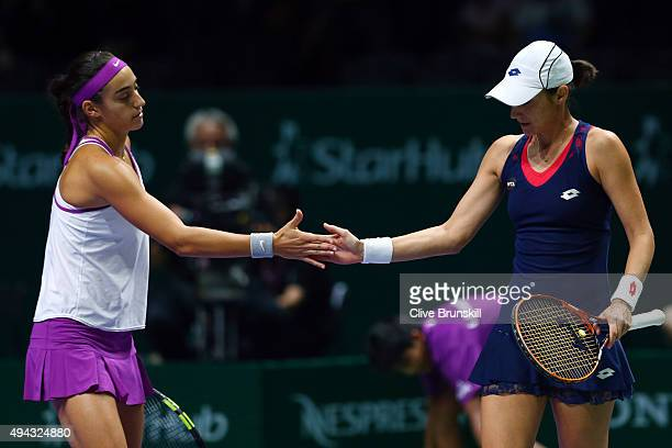 Caroline Garcia of France and Katarina Srebotnik of Slovenia in action against YungJan Chan of Chinese Taipei and HaoChing Chan of Chinese Taipei in...