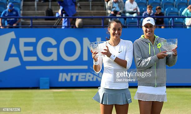 Caroline Garcia of France and Katarina Srebotnik of Slovenia pose with the trophy after winning the doubles final on day seven of the Aegon...