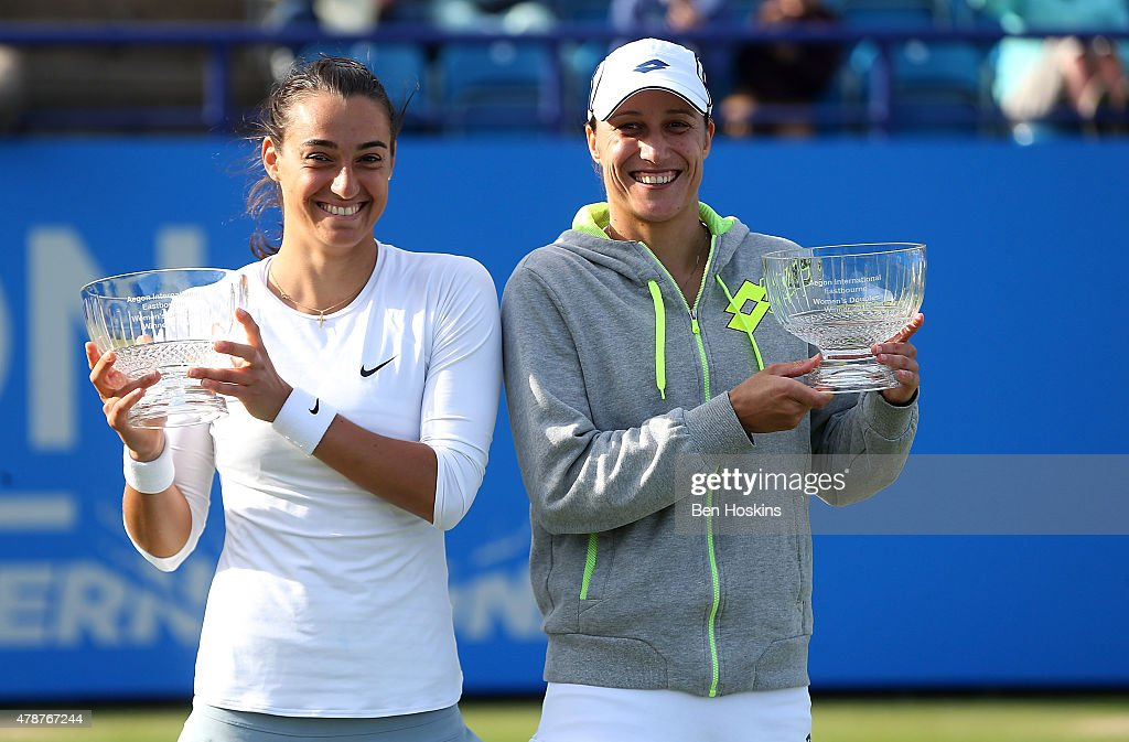Caroline Garcia of France (L) and Katarina Srebotnik of Slovenia (R) pose with the trophy after winning the doubles final on day seven of the Aegon International at Devonshire Park on June 27, 2015 in Eastbourne, England.