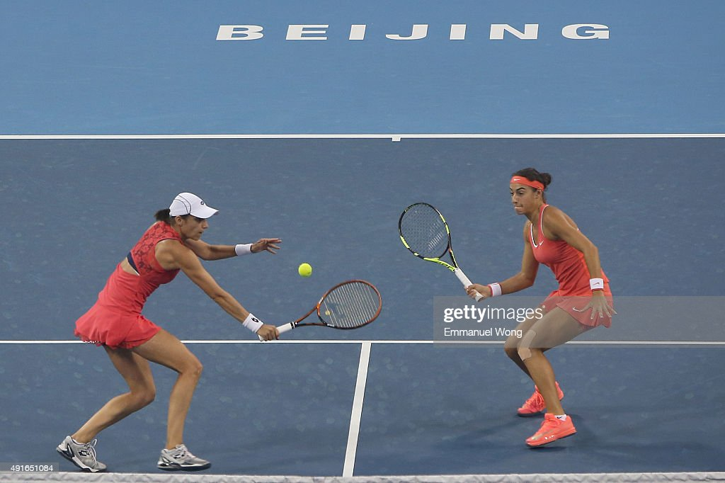 <a gi-track='captionPersonalityLinkClicked' href=/galleries/search?phrase=Caroline+Garcia&family=editorial&specificpeople=6605758 ng-click='$event.stopPropagation()'>Caroline Garcia</a> of France and <a gi-track='captionPersonalityLinkClicked' href=/galleries/search?phrase=Katarina+Srebotnik&family=editorial&specificpeople=218044 ng-click='$event.stopPropagation()'>Katarina Srebotnik</a> of Slovenia return a ball against Chen Liang of China and Yafan Wang of China during the day five of the 2015 China Open at the China National Tennis Center on October 7, 2015 in Beijing, China.