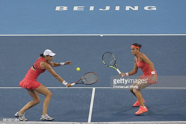 Caroline Garcia of France and Katarina Srebotnik of Slovenia return a ball against Chen Liang of China and Yafan Wang of China during the day five of...