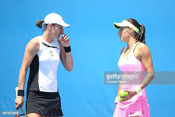 Caroline Garcia of France and Katarina Srebotnik of Slovenia talk tactics in their first round doubles match against Andrea Petkovic of Germany and...