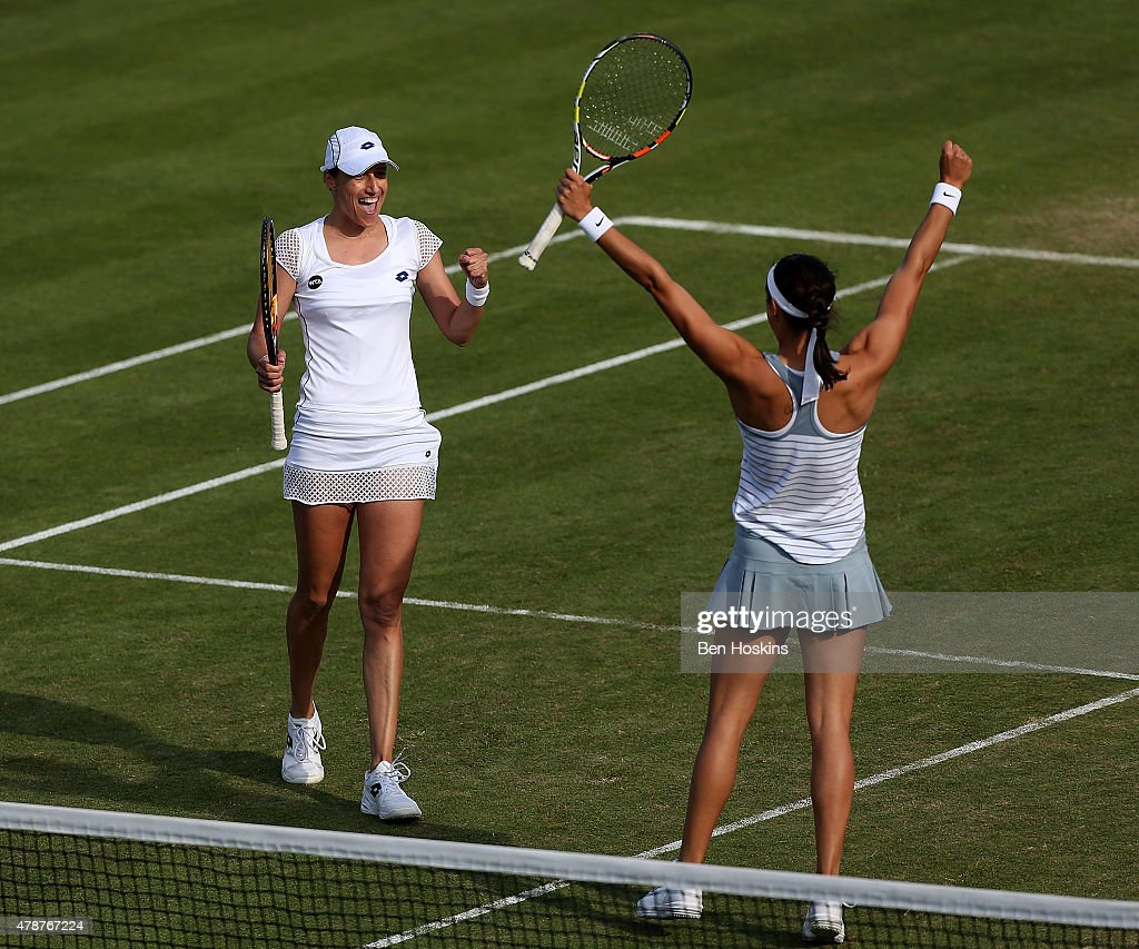 <a gi-track='captionPersonalityLinkClicked' href=/galleries/search?phrase=Caroline+Garcia&family=editorial&specificpeople=6605758 ng-click='$event.stopPropagation()'>Caroline Garcia</a> of France (L) and <a gi-track='captionPersonalityLinkClicked' href=/galleries/search?phrase=Katarina+Srebotnik&family=editorial&specificpeople=218044 ng-click='$event.stopPropagation()'>Katarina Srebotnik</a> of Slovenia (R) celebrate winning the doubles final on day seven of the Aegon International at Devonshire Park on June 27, 2015 in Eastbourne, England.