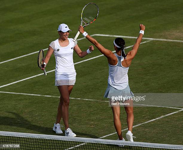 Caroline Garcia of France and Katarina Srebotnik of Slovenia celebrate winning the doubles final on day seven of the Aegon International at...