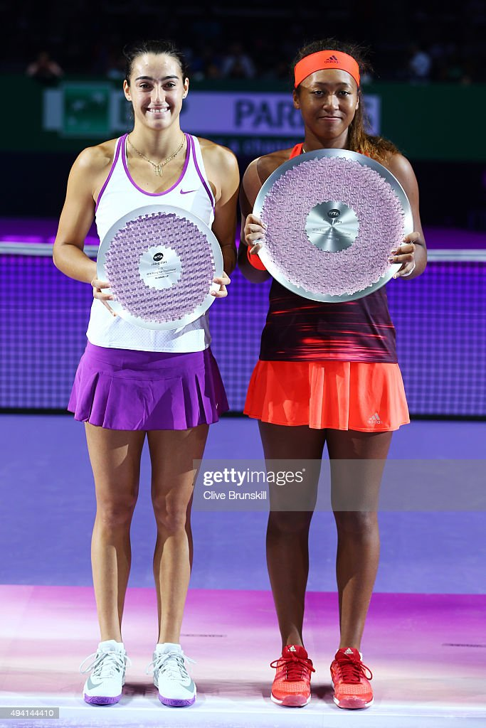 <a gi-track='captionPersonalityLinkClicked' href=/galleries/search?phrase=Caroline+Garcia&family=editorial&specificpeople=6605758 ng-click='$event.stopPropagation()'>Caroline Garcia</a> of France and <a gi-track='captionPersonalityLinkClicked' href=/galleries/search?phrase=Naomi+Osaka&family=editorial&specificpeople=13424660 ng-click='$event.stopPropagation()'>Naomi Osaka</a> of Japan hold their trophies after the WTA Rising Stars Final at Singapore Sports Hub on October 25, 2015 in Singapore.