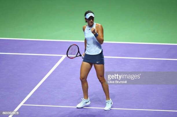 Caroline Garcia of France celebrates a point in her singles match against Simona Halep of Romania during day 2 of the BNP Paribas WTA Finals...