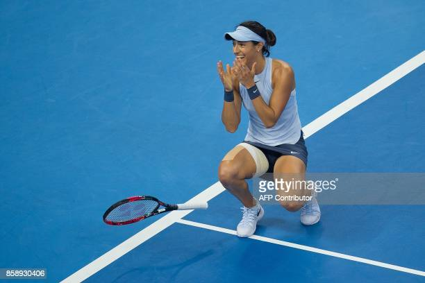 Caroline Garcia of France celebrates as she wins the women's singles final match against Simona Halep of Romania at the China Open tennis tournament...