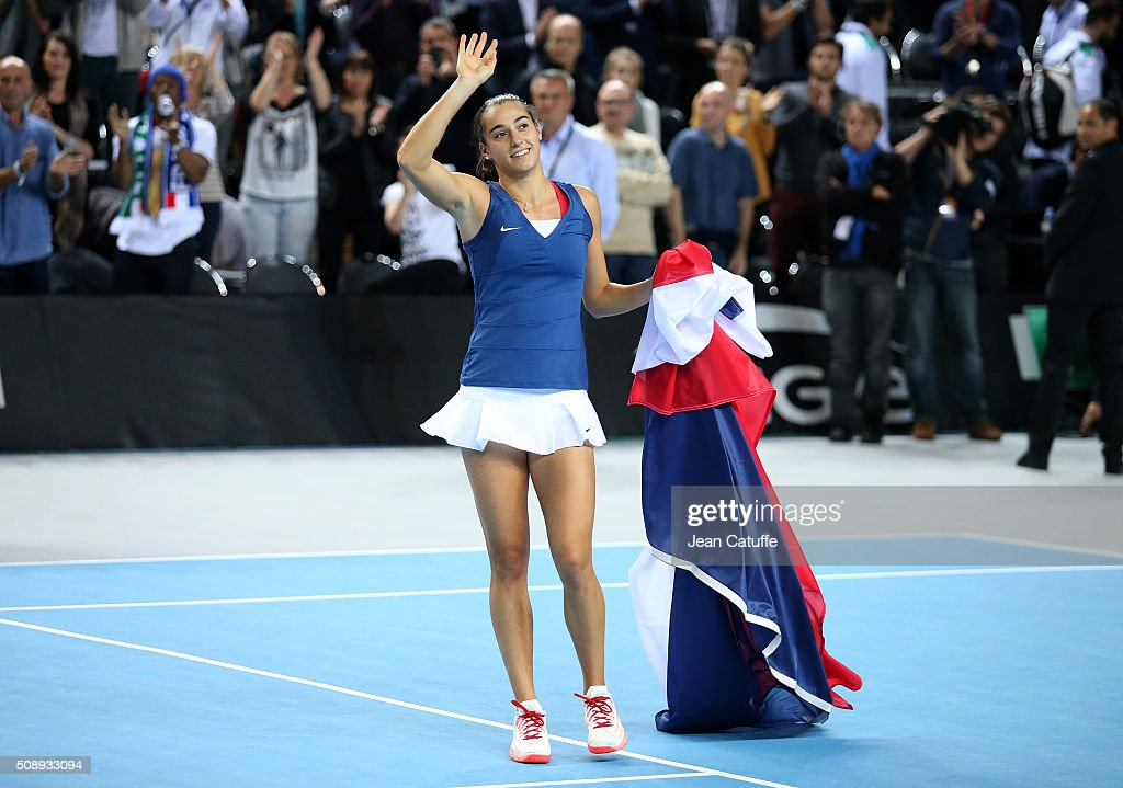 <a gi-track='captionPersonalityLinkClicked' href=/galleries/search?phrase=Caroline+Garcia&family=editorial&specificpeople=6605758 ng-click='$event.stopPropagation()'>Caroline Garcia</a> of France celebrates the victory during day 2 of the Fed Cup World Group tie between France and Italy at Palais des Sports on February 7, 2016 in Marseille, France.