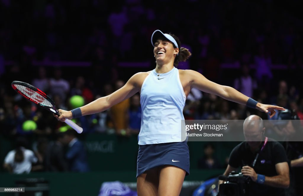 Caroline Garcia of France celebrates victory in her singles match against Caroline Wozniacki of Denmark during day 6 of the BNP Paribas WTA Finals Singapore presented by SC Global at Singapore Sports Hub on October 27, 2017 in Singapore.