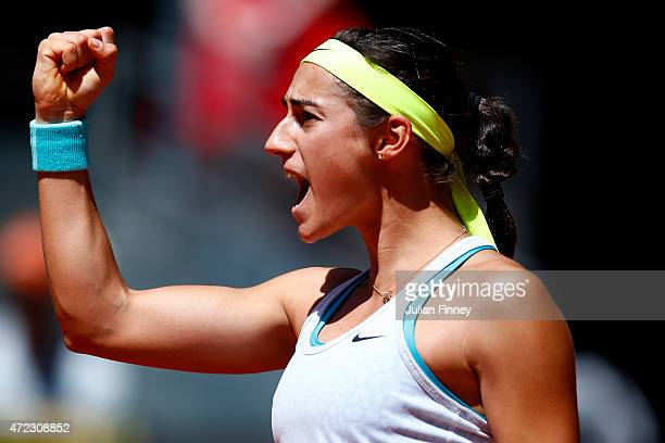 Caroline Garcia of France celebrates winning the second set against Maria Sharapova of Russia during day five of the Mutua Madrid Open tennis...