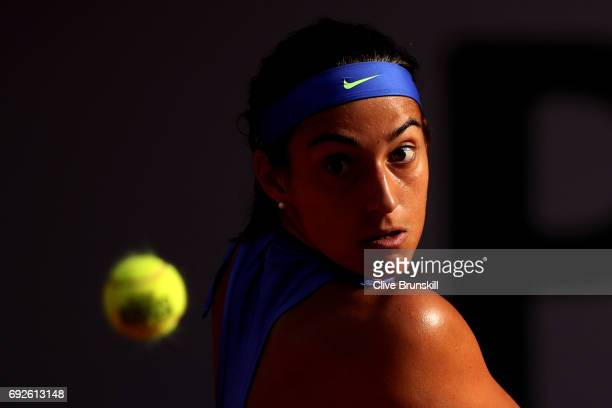 Caroline Garcia of France hits a backhand during the ladies singles fourth round match against Alize Cornet of France on day nine of the 2017 French...