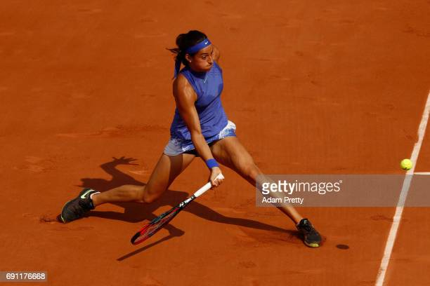 Caroline Garcia of France hits a forehand during the ladies singles second round match against Chloe Paquet of France on day five of the 2017 French...