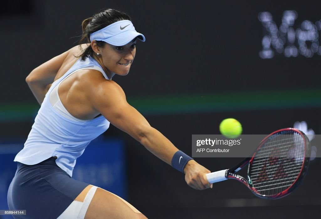 Caroline Garcia of France hits a return during the women's singles final against Simona Halep of Romania at the China Open tennis tournament in Beijing on October 8, 2017. /