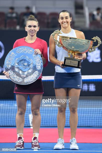 Caroline Garcia of France holding the winners trophy and Simona Halep of Romania holding the runners up trophy pose for a picture after the Women's...