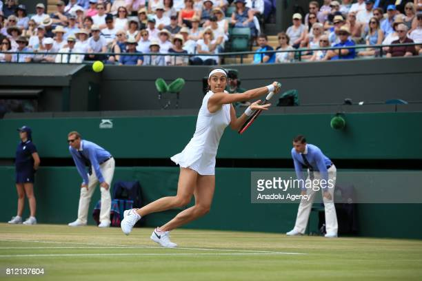Caroline Garcia of France in action against Johanna Konta of Great Britain on day seven of the 2017 Wimbledon Championships at the All England Lawn...
