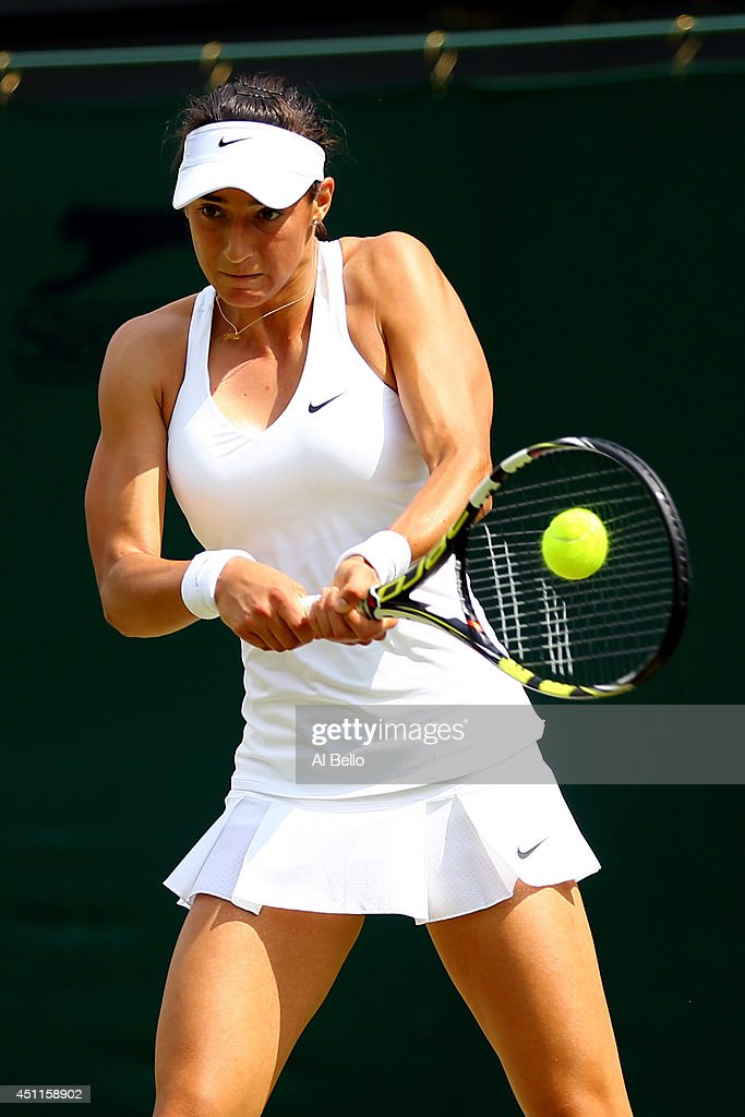 Caroline Garcia of France in action during her Ladies' Singles first round match against against Sara Errani of Italy on day two of the Wimbledon Lawn Tennis Championships at the All England Lawn Tennis and Croquet Club at Wimbledon on June 24, 2014 in London, England.