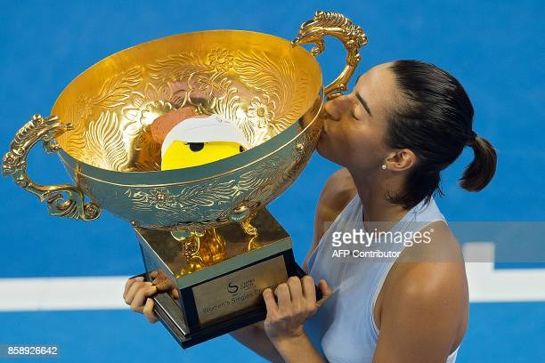 Caroline Garcia of France kisses the trophy after winning the women's singles final against Simona Halep of Romania at the China Open tennis...