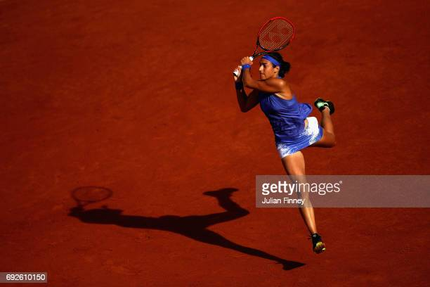 Caroline Garcia of France plays a backhand during ladies singles fourth round match against Alize Cornet of France on day nine of the 2017 French...
