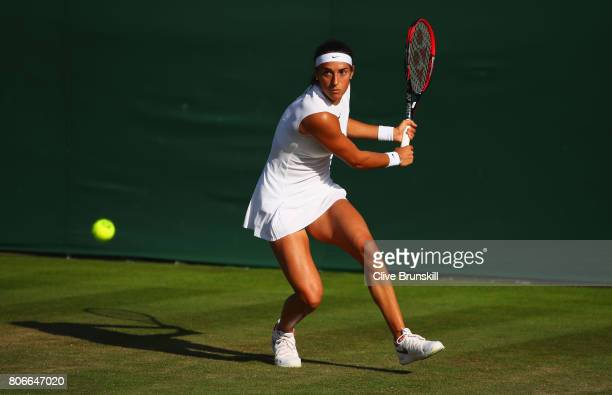 Caroline Garcia of France plays a backhand during the Ladies Singles first round match against Jana Cepelova of Slovakia on day one of the Wimbledon...