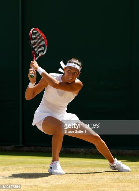 Caroline Garcia of France plays a backhand during the Ladies Singles third round match against Madison Brengle of The Unites States on day five of...