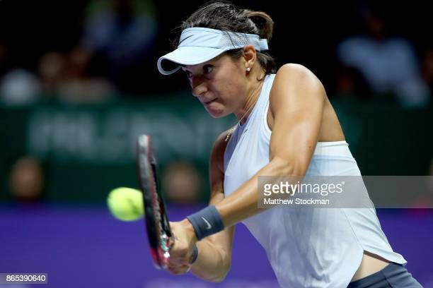 Caroline Garcia of France plays a backhand in her singles match against Simona Halep of Romania during day 2 of the BNP Paribas WTA Finals Singapore...
